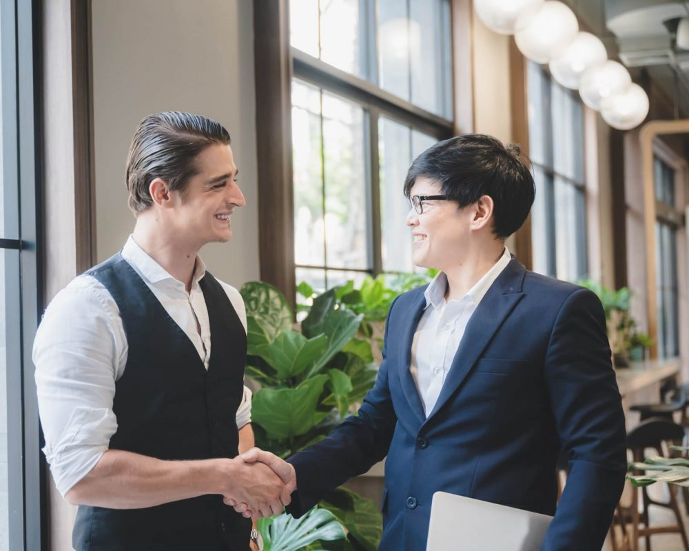 businessperson-partner-team-brainstorming-and-handshake-with-cooperation-colleague-partnership-1.jpg