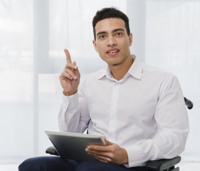 optimize-portrait-young-businessman-sitting-wheelchair-holding-digital-tablet-hand-pointing-his-finger-upward.jpg