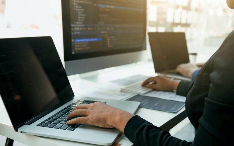professional-development-programmer-cooperating-meeting-programming-website-1.jpg